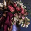 Merlot ribbon and flower arrangement