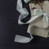 Sea Foam ribbon tied around letters