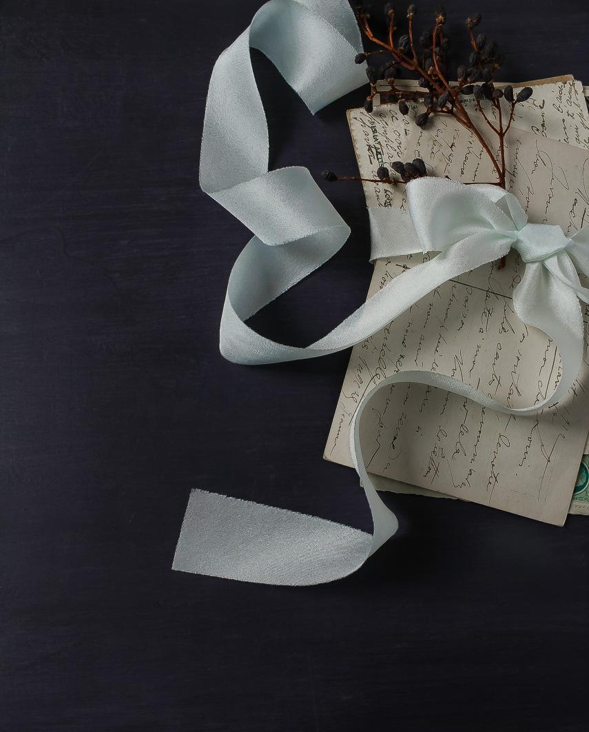 Sea Foam ribbon tied around letters