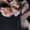 Blush ribbon with camellia